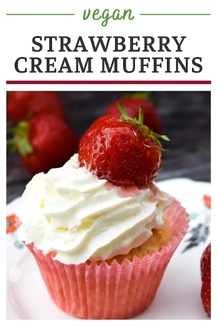 Soft vanilla vegan muffins filled with strawberry jelly glaze and topped with cream and a glazed strawberry for afternoon tea or sharing with friends.