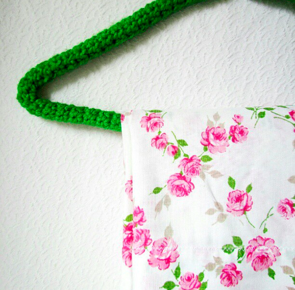 Crochet wire coat hanger and vintage fabric