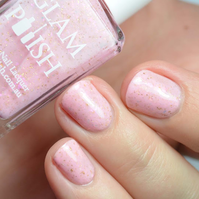 pale pink nail polish with flakies