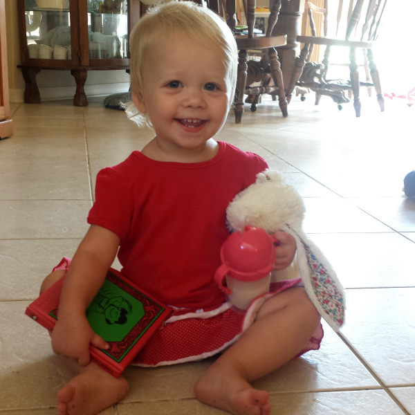 Charlie Brown Christmas book, Jellycat bunny, and zo-li bot sippy