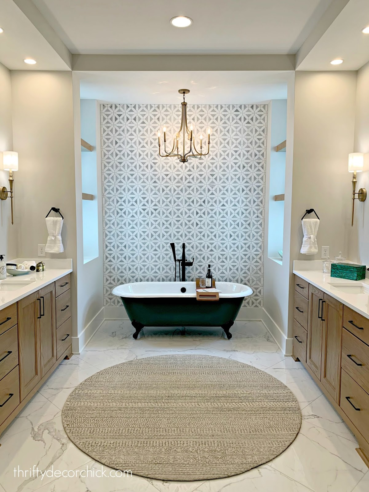 Dark stand alone tub with tile accent wall