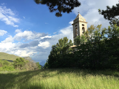 Church bell tower on the edge of Santo Stefano