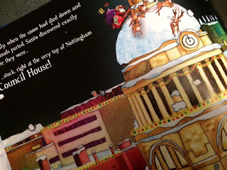Inside the book showing santas sleigh on the council house roof