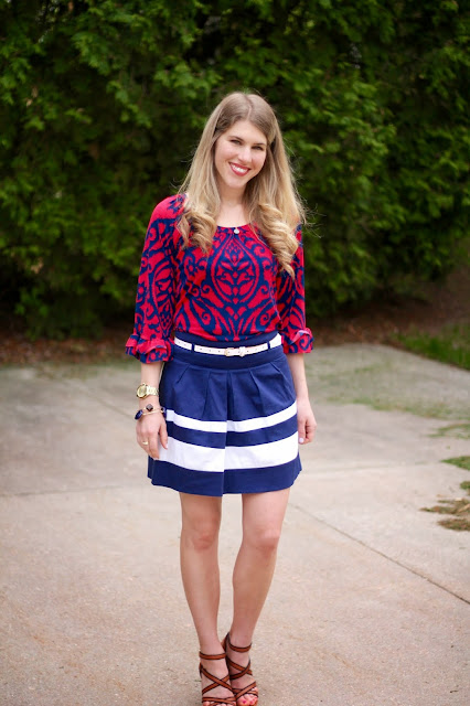red navy tunic, blue white striped skirt, white belt, wedge sandals