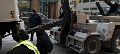 Tow Truck Down Town Image
