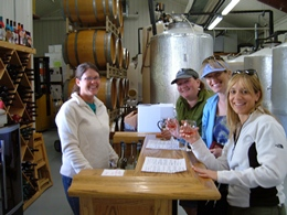 Interior photo of 4 ladies tasting wine.