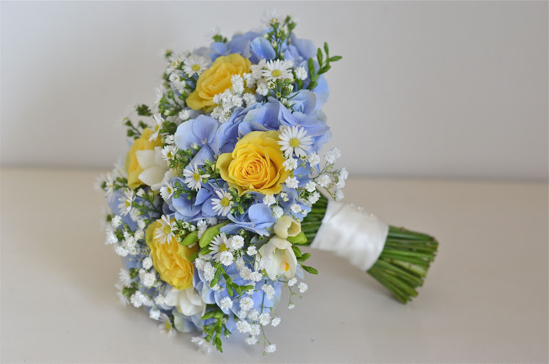 Country Style Bouquet In Blue And Yellow Using Roses Hydrangea Aster Freesia Gypsophila