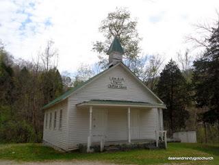 white church in Kentucky with pillars