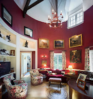 Attractive living room with Victorian design style features framed wall arts
