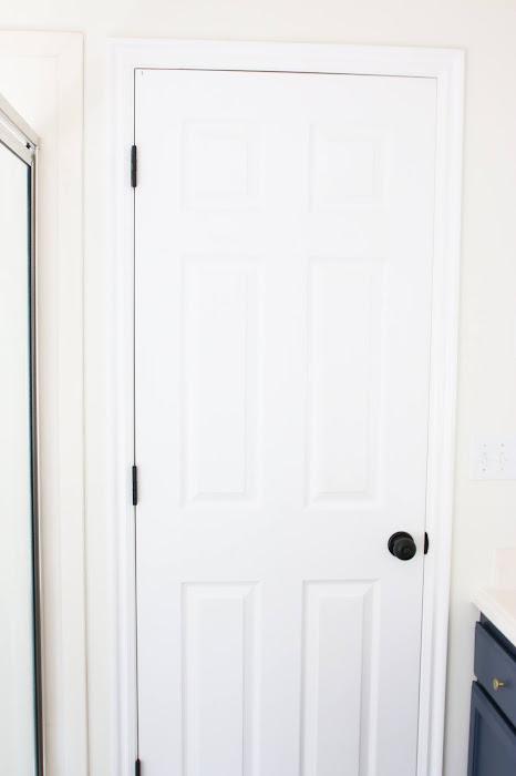 Modern farmhouse bathroom vanity. Modern farmhouse bathroom decor. Farmhouse bathroom ideas. Rustic farmhouse bathroom. Modern farmhouse bathroom fixtures. Farmhouse bathroom shower. Farmhouse bathroom pictures. Modern farmhouse bathroom tile. Budget friendly bathroom renovation. Hale navy bathroom vanity. Gold bathroom hardware. #bathroom #farmhouse #modernfamrhouse #decor #modern #rustic