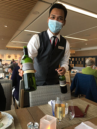 Here, one of many helpful Viking Sky waiters, caters to our every whim (Source: Palmia Observatory)