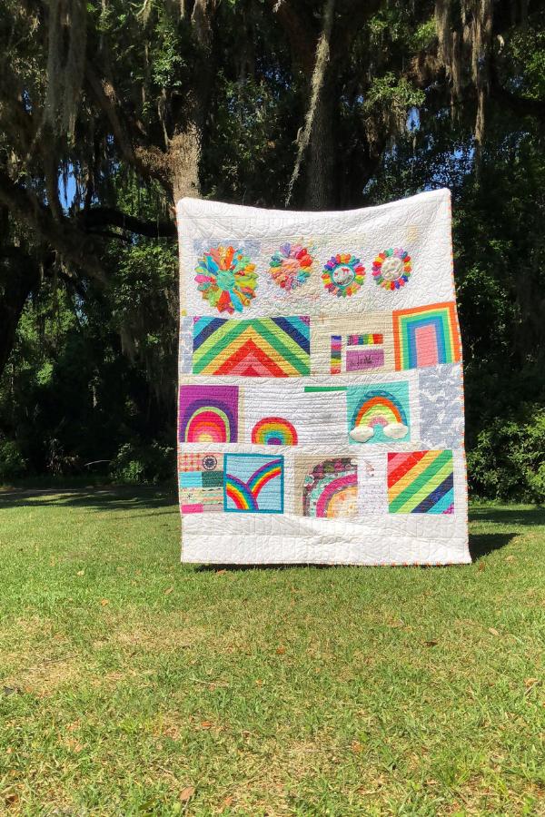 Rainbow quilt by Modern Sewciety | Shannon Fraser Designs #quiltsinthewild