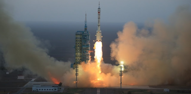 The Long March-2F carrier rocket carrying China's Shenzhou 11 manned spacecraft blasts off from the launch pad at the Jiuquan Satellite Launch Center in Jiuquan, northwest China's Gansu Province, Oct. 17, 2016. Photo & Caption Credit: Xinhua / Li Gang
