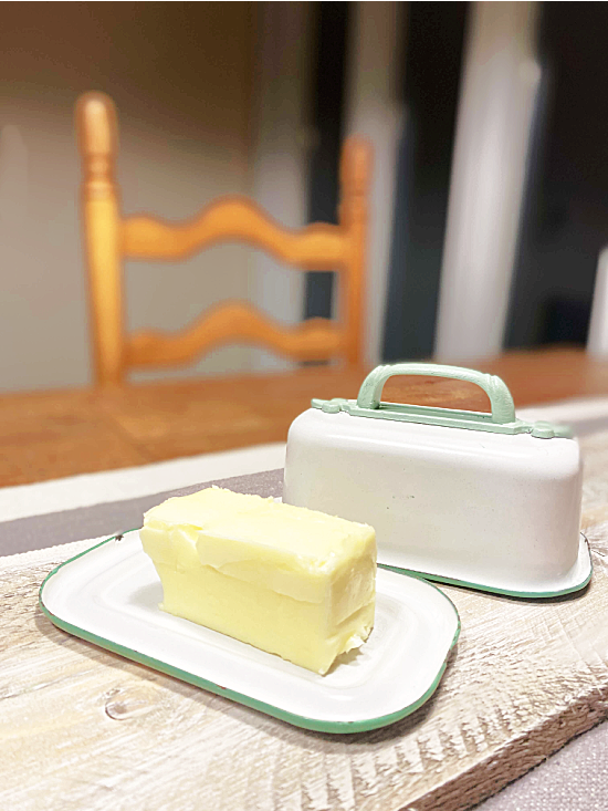 enamelware container turned butter dish with butter