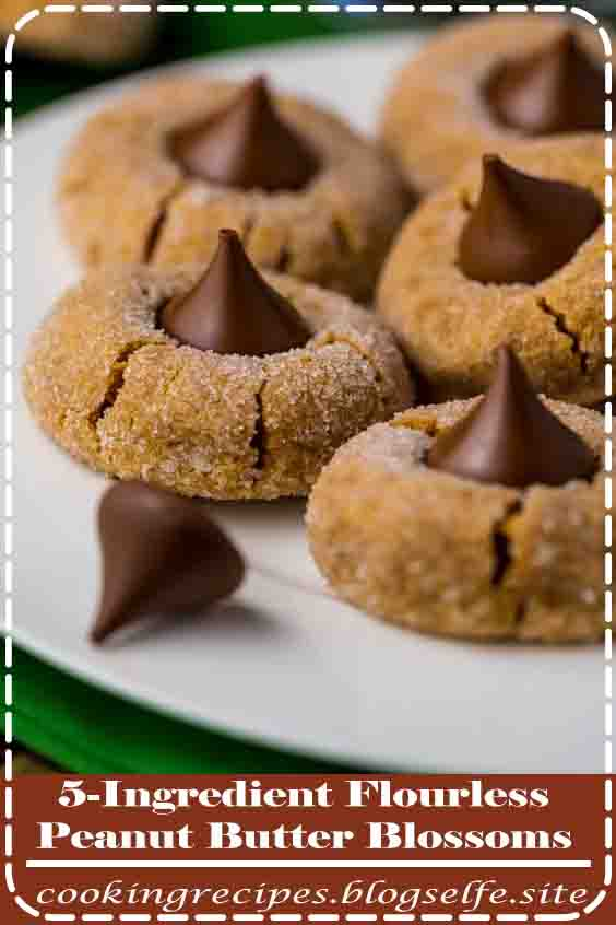 4.9 ★★★★★ | Peanut butter lover's go crazy over these 5-Ingredient Flourless Peanut Butter Blossoms! Soft, chewy, and stuffed with a chocolate hershey kiss. They're the perfect Christmas cookie! #cooking #recipes #desserts #baking #peanut #butter
