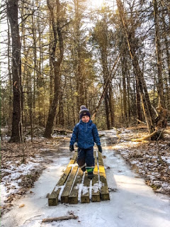 Child hikes at Cutts Island in Kittery Maine