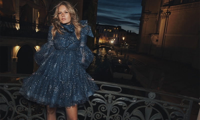 Zimmermann features Rhythm ruched glitter mini dress in fall 2021 campaign.
