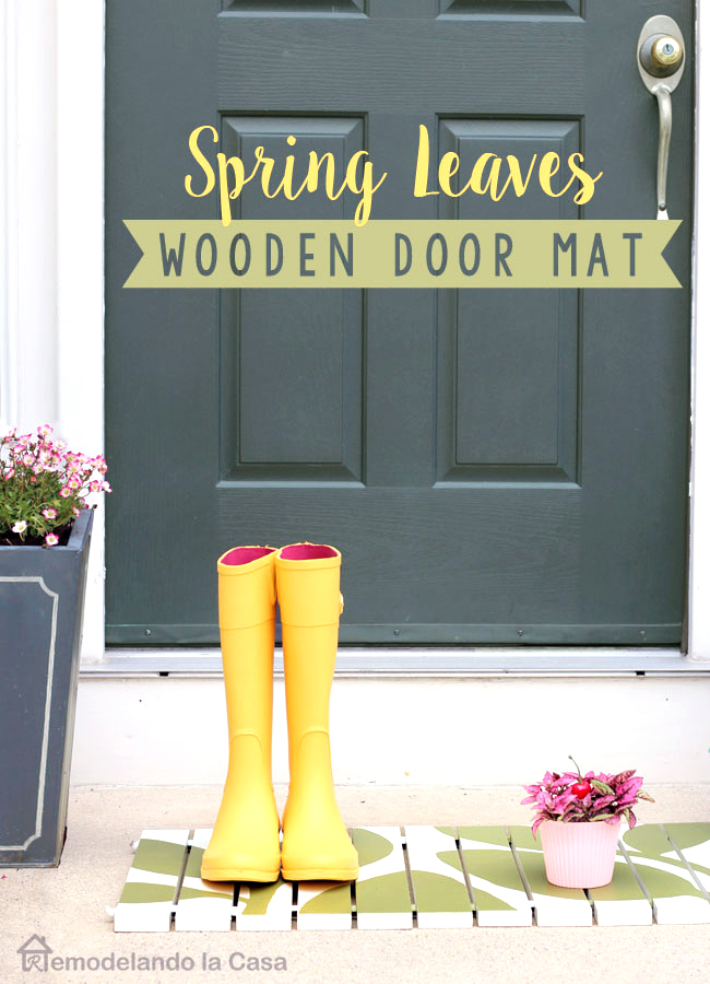 Front door with yellow boots on DIY wooden door mat
