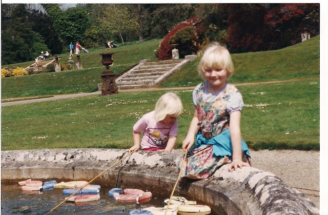 throwback photo of me and my sister fake fishing in a pond