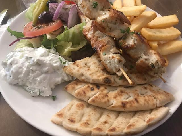 Greek meal, pitta break, chicken, chips and salad