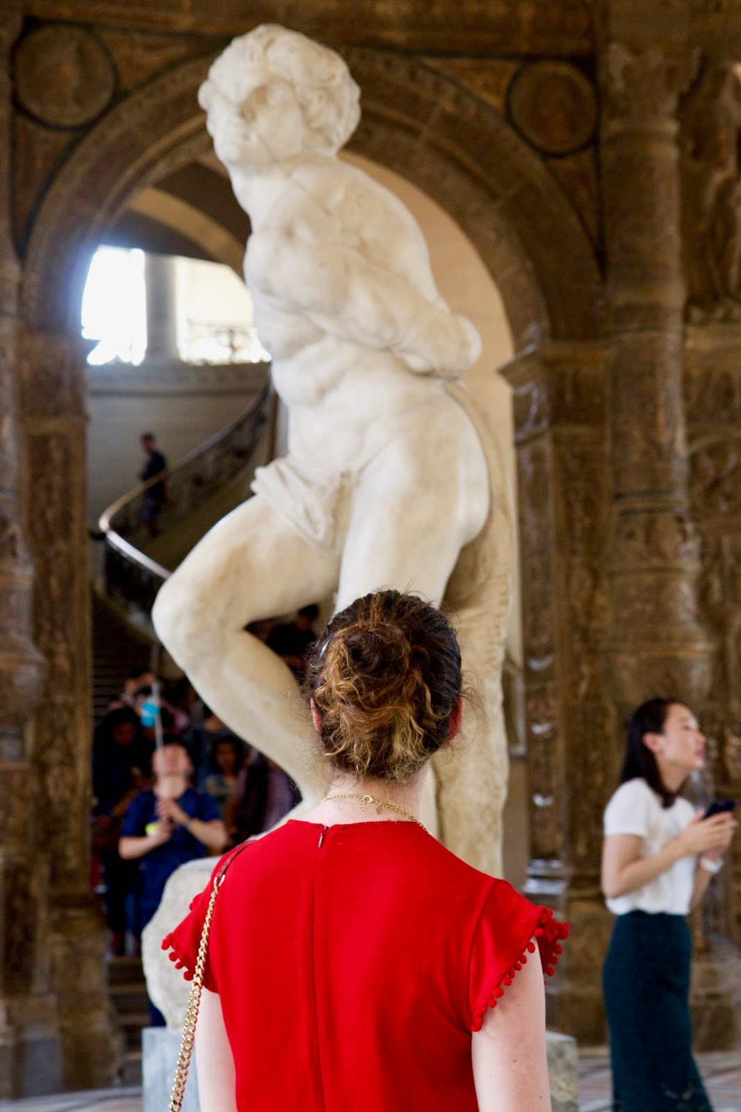 Fashion blogger Kathleen Harper at the Louvre in Paris France