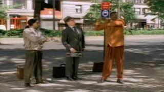 Bill Irwin breakdances at a bus stop. sesame street zoe's dance moves
