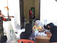 Hebat ! Babinsa Koramil 1001-05 Lampihong Dampingi Kegiatan Posyandu di Desa Binaan