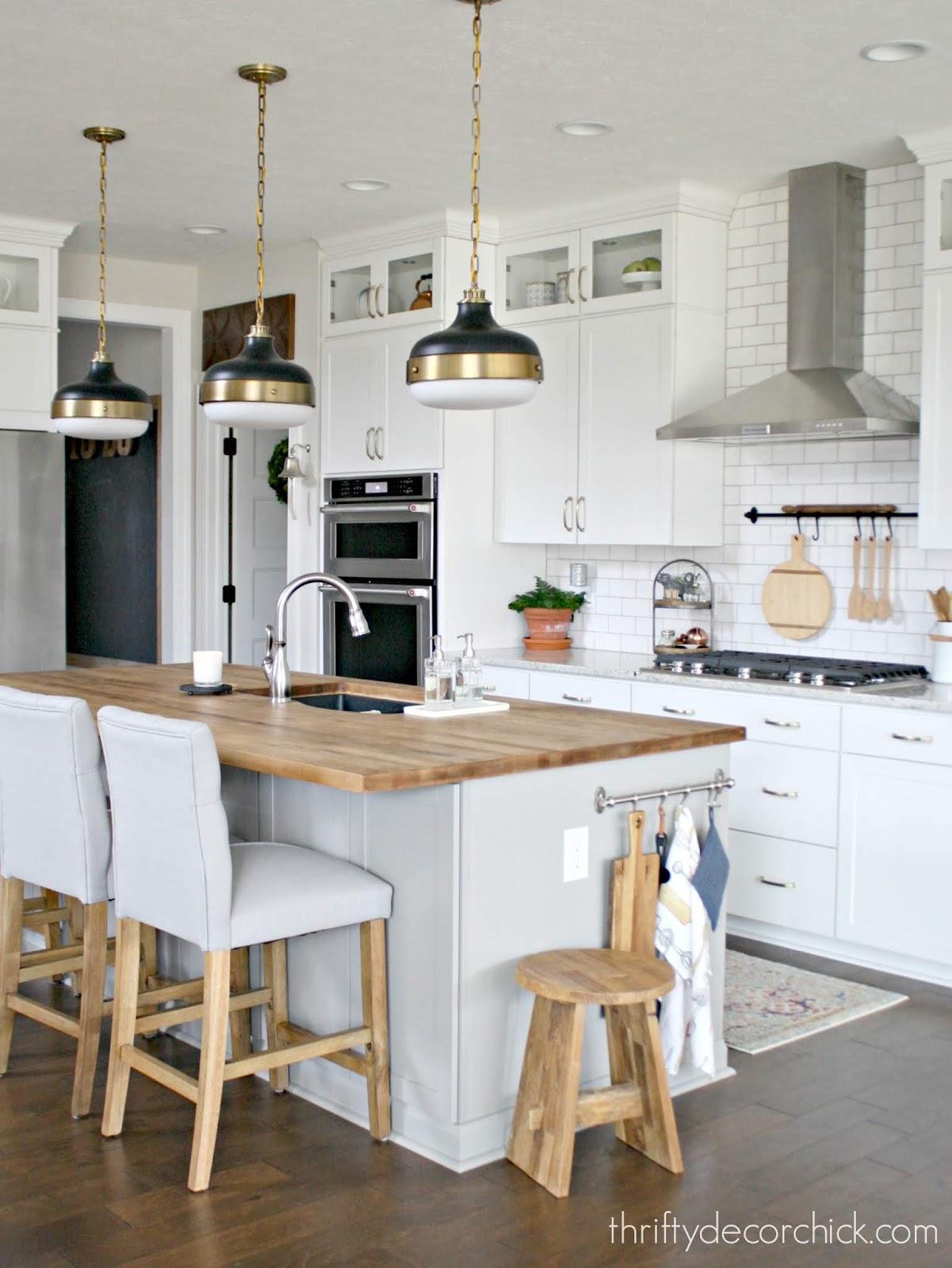 Light gray kitchen island white cabinets