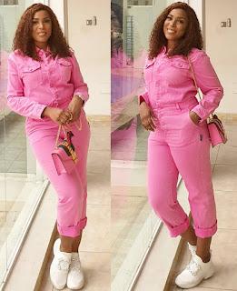 Linda Ikeji glow on a Pink Denim Jumpsuit