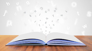 Picture of a book with letters flying out of the pages.