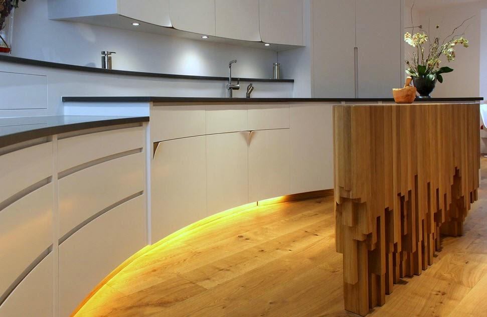 Blanca curva y con niveles una cocina muy personal