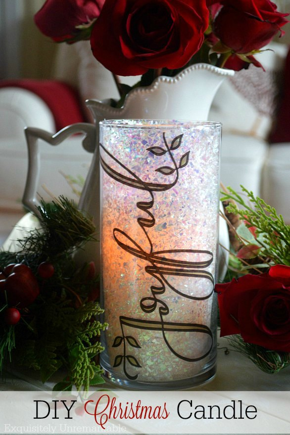 DIY Christmas Glitter Candle words on photo of Joyful glitter candle on table with Christmas greenery