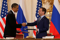 Barack Obama and Dmitry Medvedev after signing the 'New START' treaty in Prague