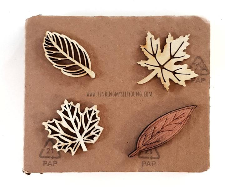 wood laser cut stencil pieces on cardboard