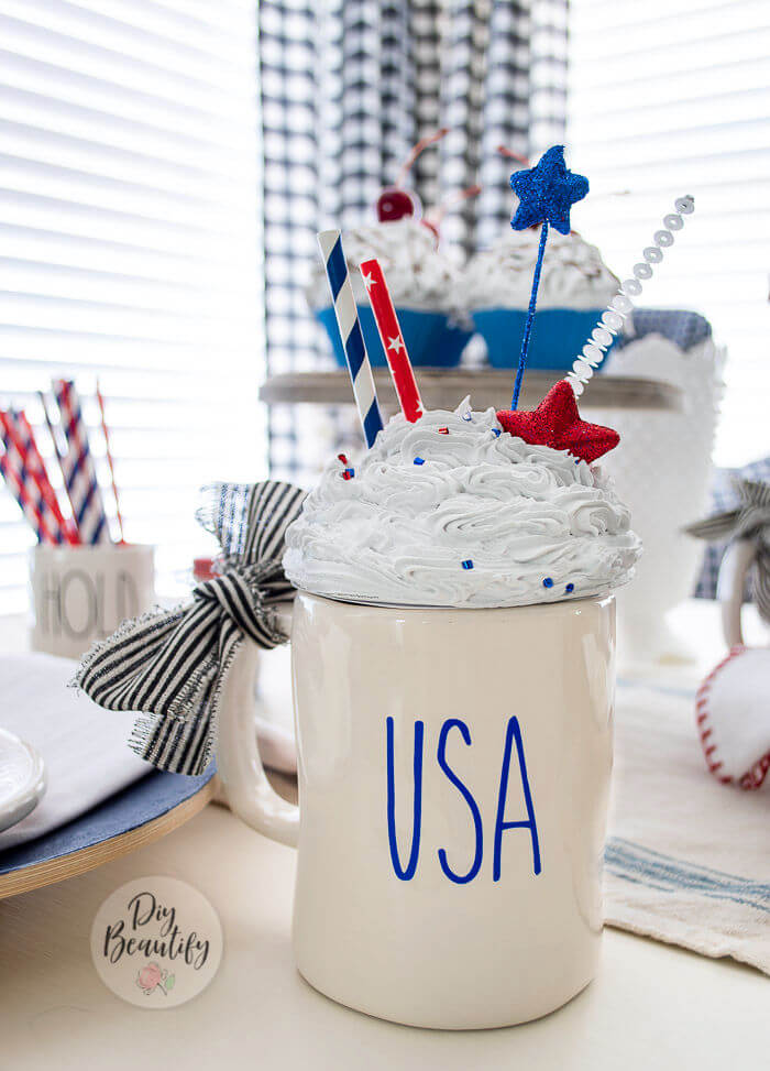 Rae Dunn mug with faux whip patriotic topper
