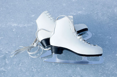 A Pair of Ice Skates on Ice