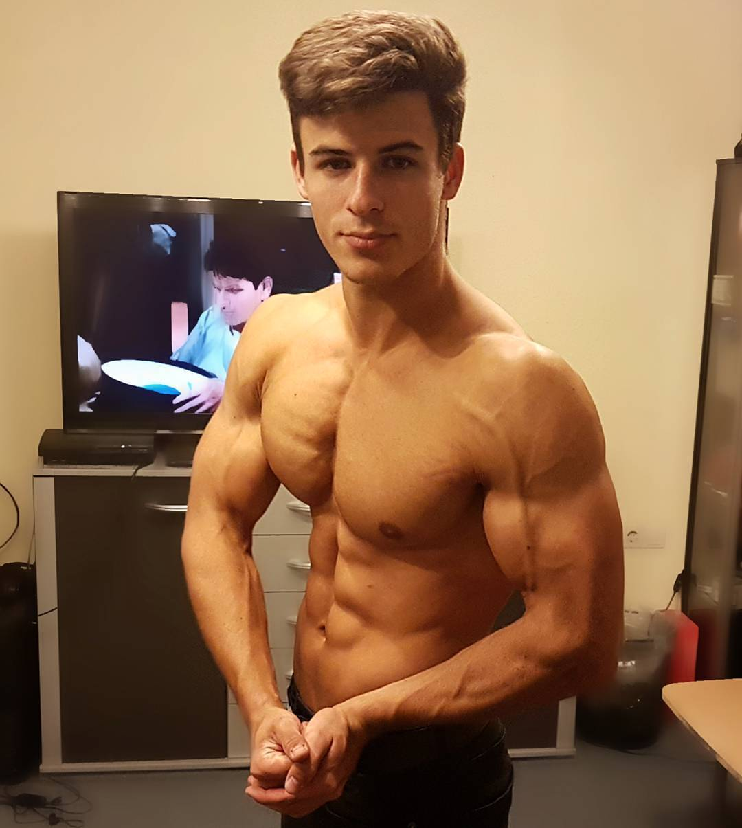 handsome-young-fit-shirtless-guy-flexing-muscular-body-pecs-veiny-biceps