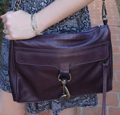 Rebecca Minkoff Deep Purple MAC bag worn with printed skirt and silver bracelets