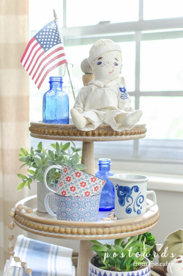 red white and blue patriotic decor on a wood three tier tray