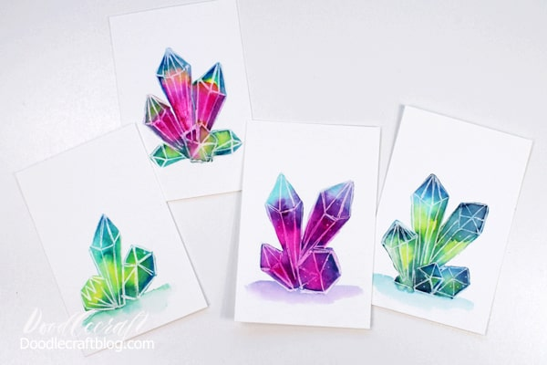 Iridescent, rainbow, shimmery galaxy watercolored in crystal shapes for the perfect little pieces of art.
