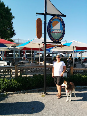 Gosman's Dock in Montauk, Long Island NY is a popular gathering place in Summer.  Several waterfront restaurants and shops draw crowds on Summer evenings
