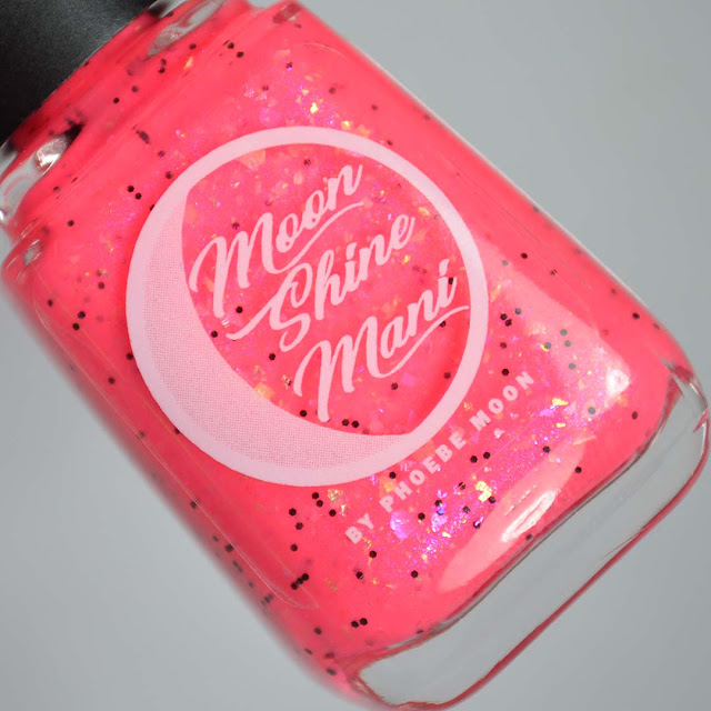 neon pink nail polish with flakies in a bottle