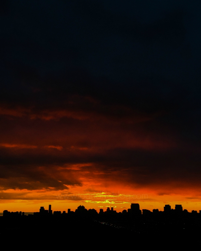 orange sunset over the city of toronto