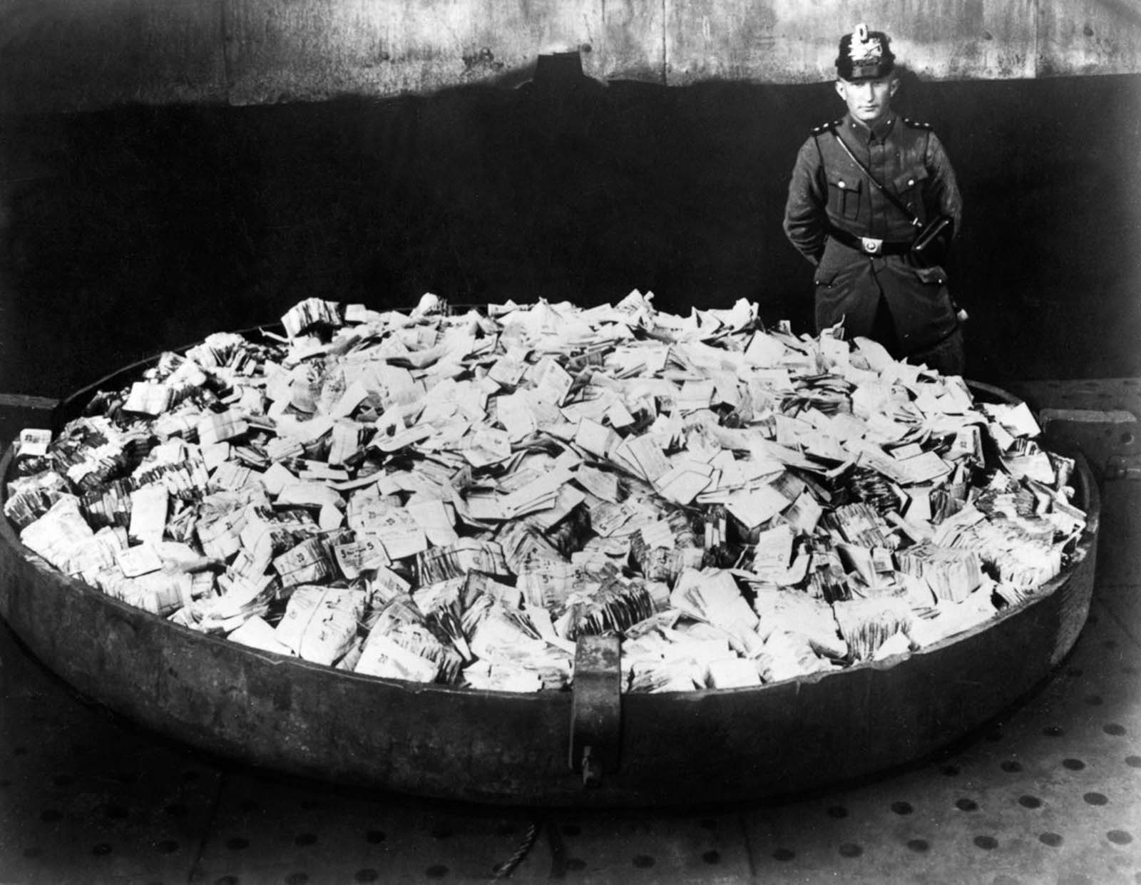 Worthless banknotes are collected to be burned. 1923.