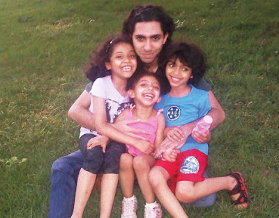 Badawi with his children Najwa, Miriam and Terad Photo: Amnesty International