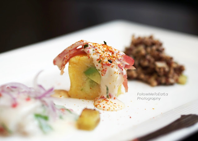 Maki-Shaped Causa filled with Avocado, Cucumber, topped with Tuna in Acevichada Sauce