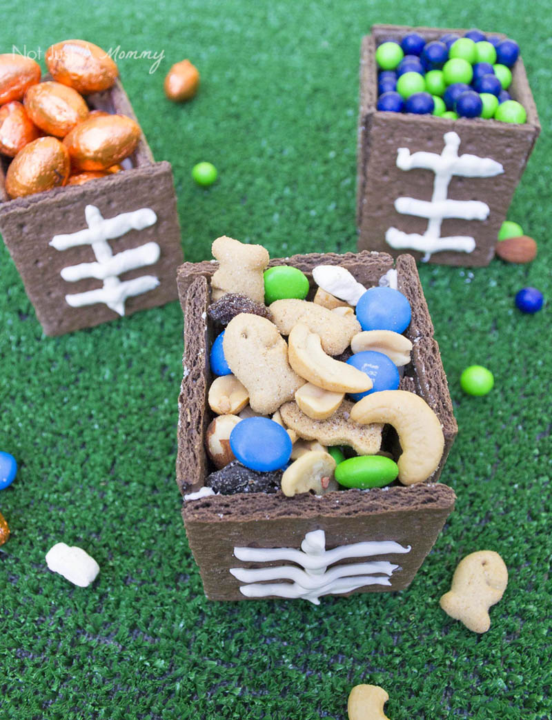 Fill edible football snack boxes with nibbles for your game watching party