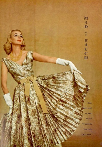 Model Dorian Leigh posing in silk print afternoon dress by Madeleine de Rauch 1956. Photo by Jacques Decaux