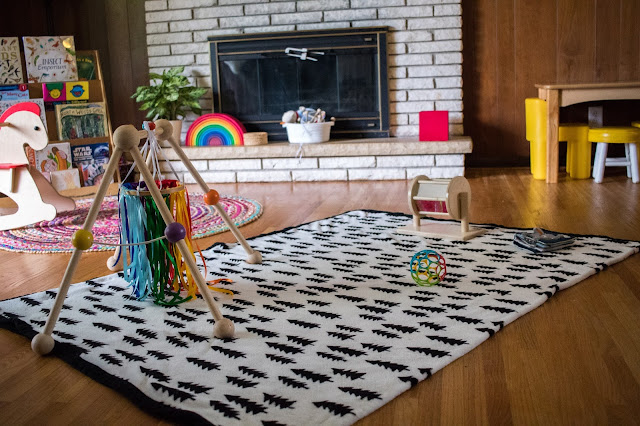 Creating a Montessori baby play space for a non-moving baby. Setting things around the floor can help to encourage movement and the free exploration of materials.