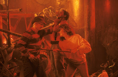 A Nightmare on Elm Street 3: Dream Warriors movie still where three kids try to kill Robert Englund's Freddy Kruger